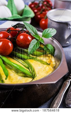 Omelette with vegetables in a serving bowl. Selective focus.