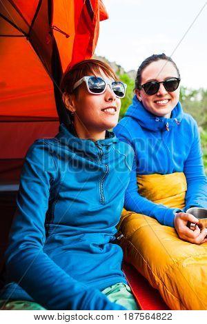 Two Girls Having Fun Near The Tent Camping.