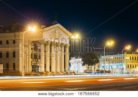 Gomel, Belarus. Traffic And Light Trails Near Building Of Gomel Regional Drama Theatre On The Lenin Square. Summer Night. Long Exposure