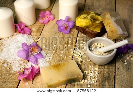 Organic cosmetic photo. Components herb cosmetics and cream. Handmade soap with oatmeal, essential oil and flowers. Good for healthy lifestyle, skin care products. Eco friendly. Selective focus.