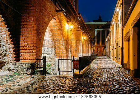 Riga, Latvia. Part Of Old The City Wall In Torna Street In Lighting At Evening Or Night Illumination In Old Town. Blue Hour