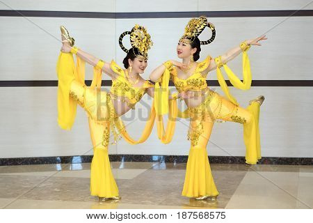 two beautiful girl actres in yellow traditional chinese stage costumes