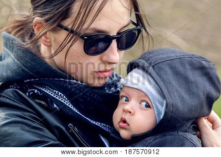 mother and son in the Park in a leather jacket