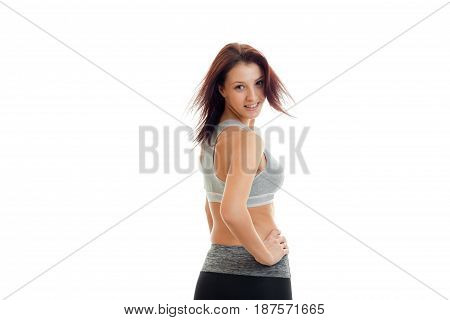 gorgeous young girl with beautiful hair is worth turning your back to the camera isolated on white background