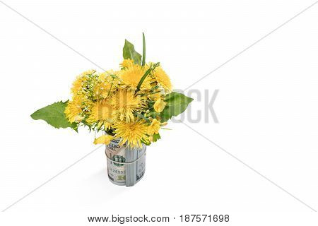 Beautiful spring bouquet with dandelions and wild flowers standing in a bunch of dollars isolated on a white background