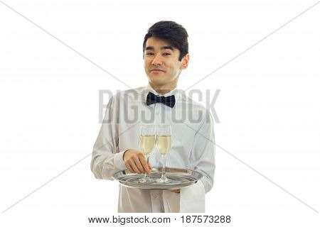 beautiful funny waiter shirt holding a tray with glasses and smiling isolated on white background