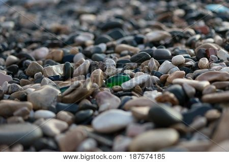 Background sea pebbles a lot of wet rocks