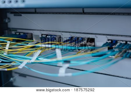 Modern telecommunications. Close up of network cables being connected to a modern network switch of a data server