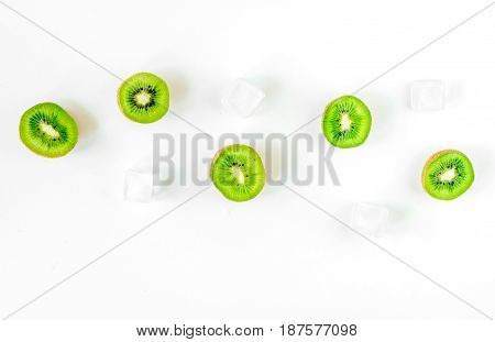 fresh green fruits with kiwi on white desk background top view mock-up