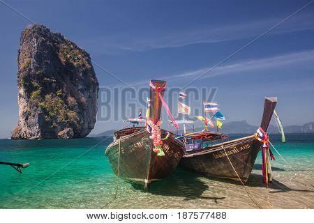 KRABI, Thailand - February 4, 2014: Traditional longtail boats on Koh Poda island, Thailand