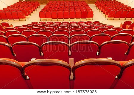 red auditorium chairs empty in theatre wood
