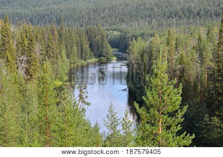 View from the hill on river and wild forest. Northern Finland.
