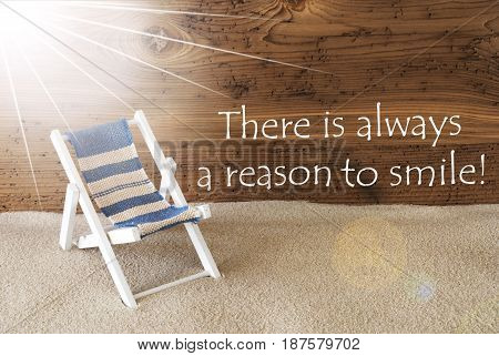 Sunny Summer Greeting Card With Sand And Aged Wooden Background. English Quote There Is Always A Reason To Smile. Deck Chair For Holiday Or Vacation Feeling.
