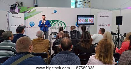 KIEV - UKRAINE - MAY 2017: TV and Radio International Fair in Kiev. The lecturer shares his experience with the seminar participants about the new photo and video equipment