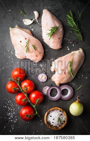 Raw chicken fillet with spices . Food background cooking ingredients. Fresh meat. Chicken breast.
