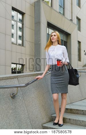 Businesswoman standing On Street and Holding hot coffee.