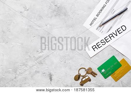 hotel reservation blank and keys on stone desk background top view mockup