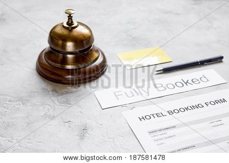 room reservation form on hotel reception stone desk background
