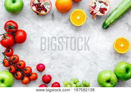 cooking salad with fresh fruits and vegetables on stone desk background top view mock-up