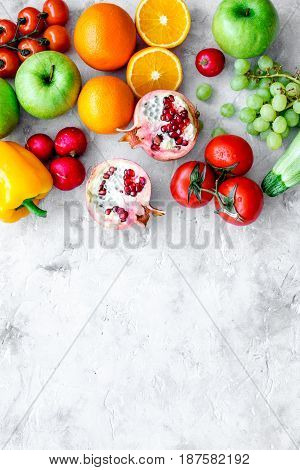 diet food with fresh fruits and vegetables salad on stone background top view mockup