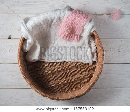 basket pink hood and knitted blanket for a newborn photo shoot