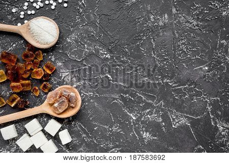 lumps of sugar with spoons sweet set on dark kitchen table background top view mockup