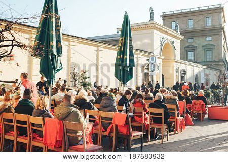 Munich, Germany, December 29, 2016: Popular among the local population and tourists is the open-air restaurant on the Odeonsplatz in Munich. The winter vacation. Daily life in Europe.