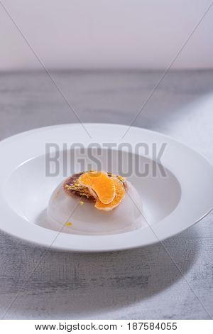 Coconut panna cotta with slices of oranges.