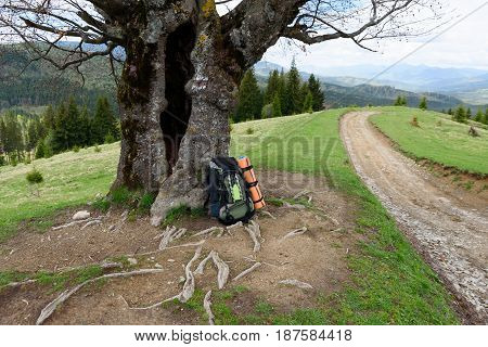 Backpack tourist lies on the ground rest rest on a journey