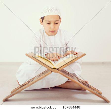 Happy kids reading Koran