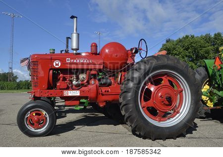 YANKTON, SOUTH DAKOTA, August 19, 2106: The restored Farmall Super M tractor is displayed at the annual Riverboat Days celebrated the third weekend of August in Yankton.