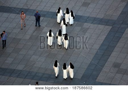 ZAGREB, CROATIA - MAY 31: Nuns crossing Ban Jelacic Square in Zagreb, Croatia on May 31, 2015.