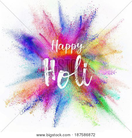 Colored powder explosion on white background. Happy Holi concept.