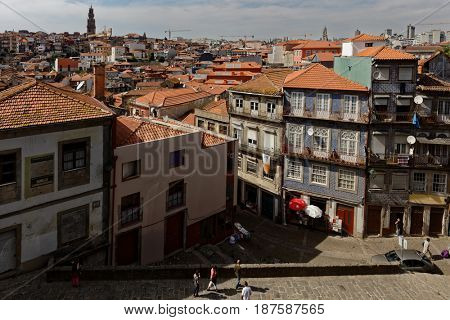 PORTO, PORTUGAL - MAY 8, 2017: Cityscape of historical district Ribeira. Since 1996, the historical center of Porto is listed as UNESCO World Heritage site