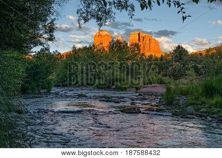 a scenic reflection of cathedral rock Sedona Arizona at sunset