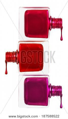 Collection of different nail polishes. nail polishes poured from a bottle. Isolated on white background