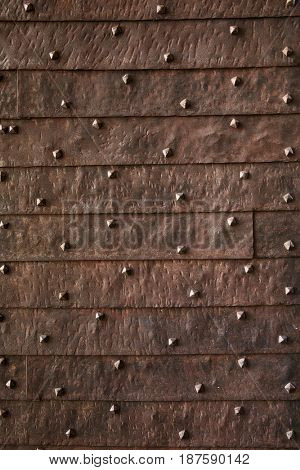 Texture of the old gate with metal rivets