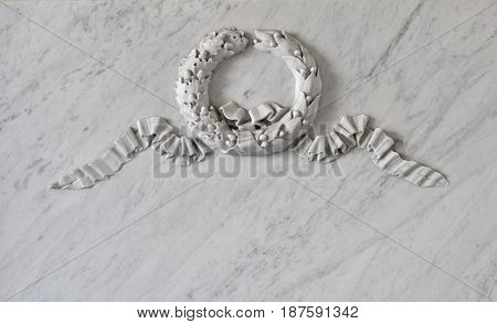 Memorial marble plate with wreath relief as background for text. Beginning of XIX century.