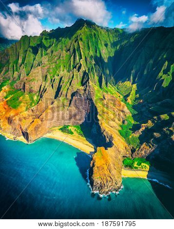 Hawaii beach, Kauai. Na pali coast aerial helicopter view from above. Hawaiian travel destinaton. Napali coastline in Kaui, Hawaii, USA. Aerial of Honopu arch.