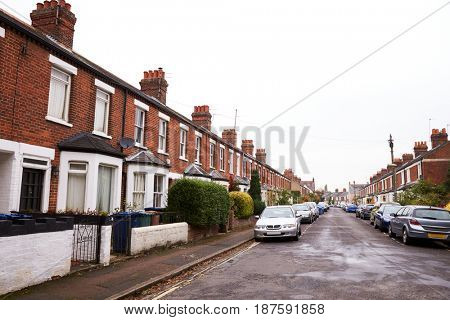 OXFORD/ UK- OCTOBER 26 2016: Exterior Of Victorian Terraced Houses In Oxford With Parked Cars