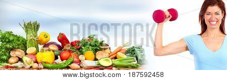 Sportive woman with fruits and dumbbell