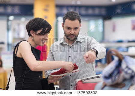A young attractive couple changes the look with new shoes  At Shoe Store