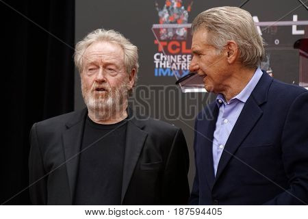 LOS ANGELES - MAY 17:  Ridley Scott, Harrison Ford at the Ridley Scott Hand and Foot Print Ceremony at the TCL Chinese Theater on May 17, 2017 in Los Angeles, CA