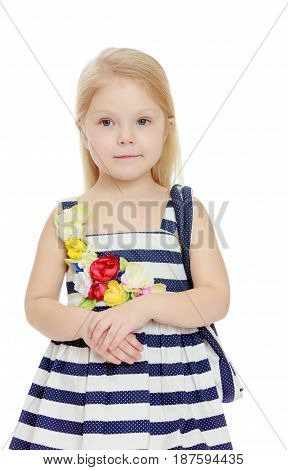 The little blonde girl in striped summer dress with beach bag on shoulder.Isolated on white background.