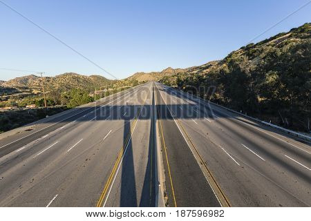 Closed empty ten lane freeway in the San Fernando Valley area of Los Angeles, California.