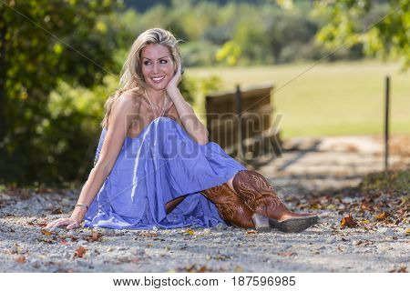 Beautiful blonde model posing in a  field