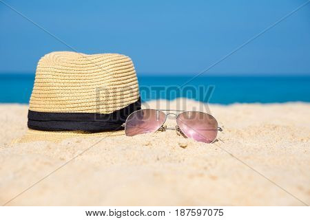 Sunglasses with hat on the beach, summer
