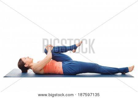 Woman doing Hatha Yoga asana Ardha pawanmuktasana - knees-to-chest pose. Stretches back isolated on white background