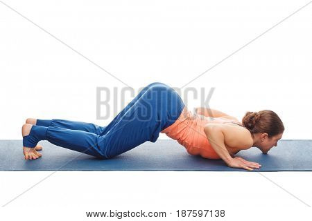Woman doing Hatha yoga asana Ashtangasana - eight-limbed pose posture isolated on white background