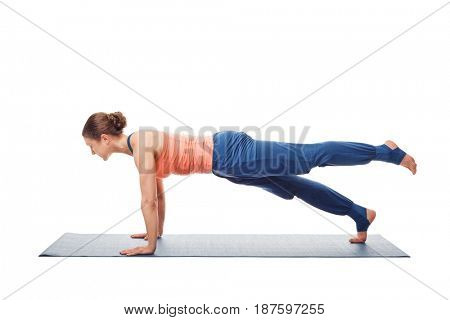 Woman doing Hatha yoga asana Utthita chaturanga dandasana - extended four-limbed pose variation isolated on white background